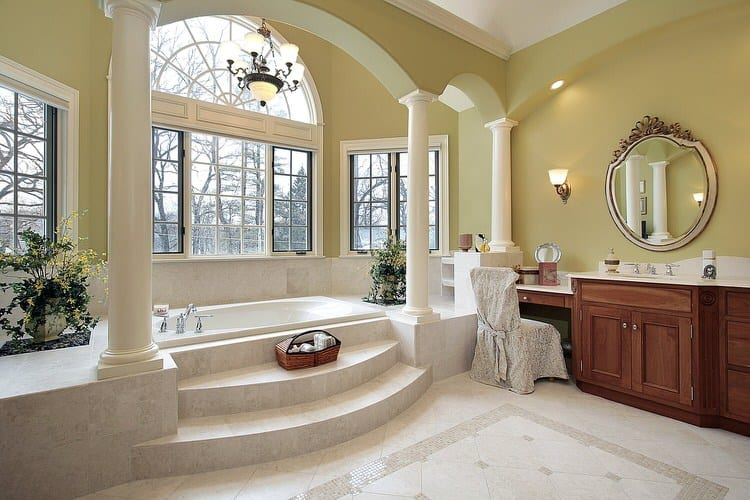 A bathroom fit for royalty in this Victorian home features columns  arches  a Palladian window  The entire bathroom is painted in yellow limestone. 42 Jaw Dropping Luxury Bathrooms   InteriorCharm