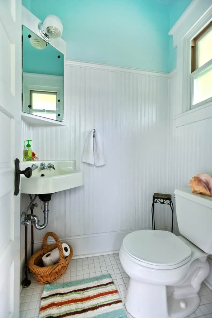 This vintage powder room design makes good use of existing fixtures  The corner sink  toilet  medicine cabinet and light fixture were already there. 38 Cozy Small Bathrooms   InteriorCharm