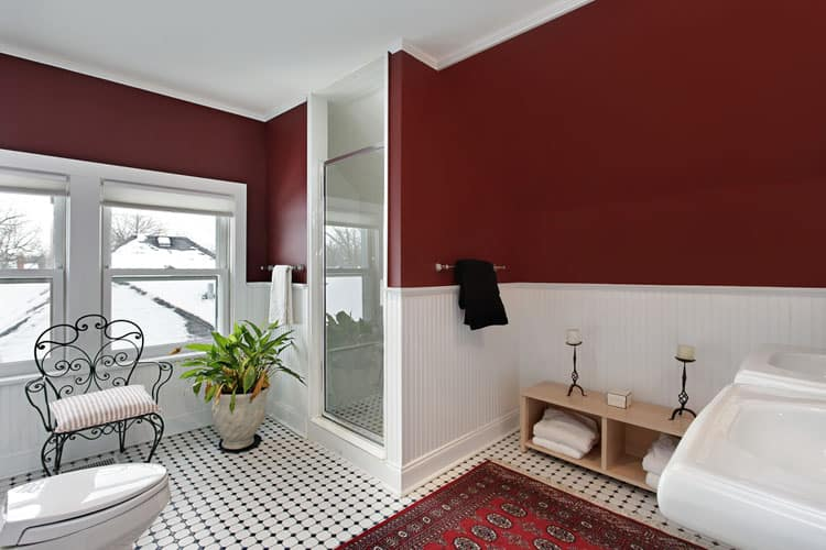 This Bathroom Is Full Of Charming Details. The Dark Red Walls Make The  White Fixtures And Bead Board Pop While The Black And White Tile Floor  Oozes With ...