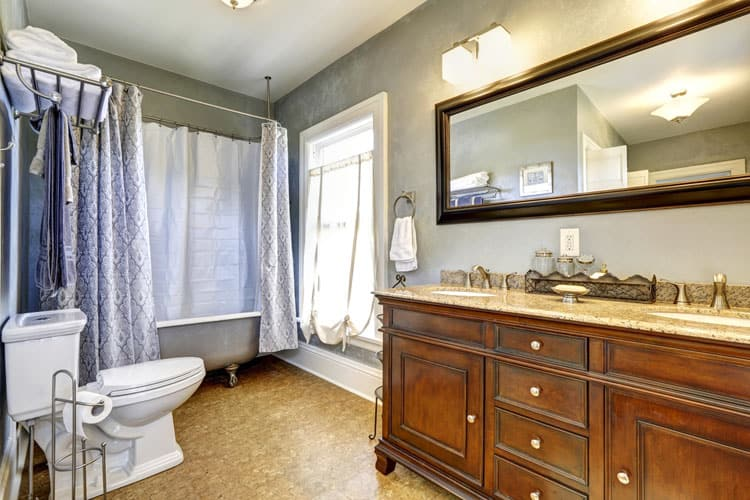 the custom vanity in this bathroom could easily take center stage but by encircling the clawfoot tub with a sumptuous shower curtain the latter gains a bit - Clawfoot Tubs