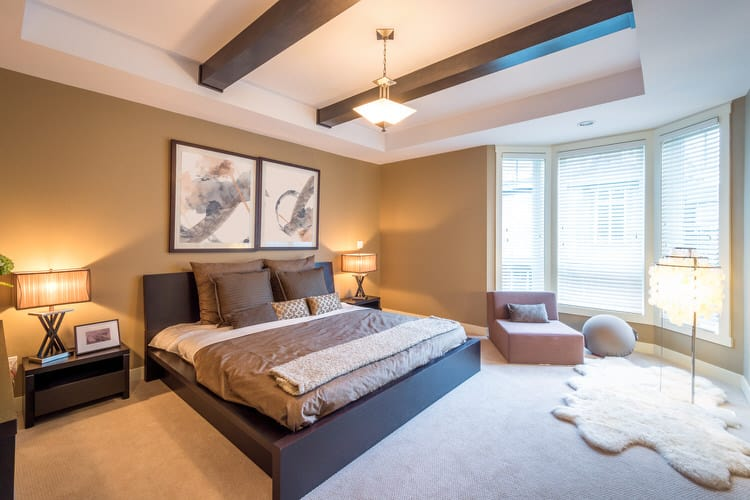 Use Color To Create Consistency When Using Disparate Types Of Furnishings  In A Master Bedroom. The Chocolate Brown Bed Frame, Nightstand And Ceiling  Beams ...