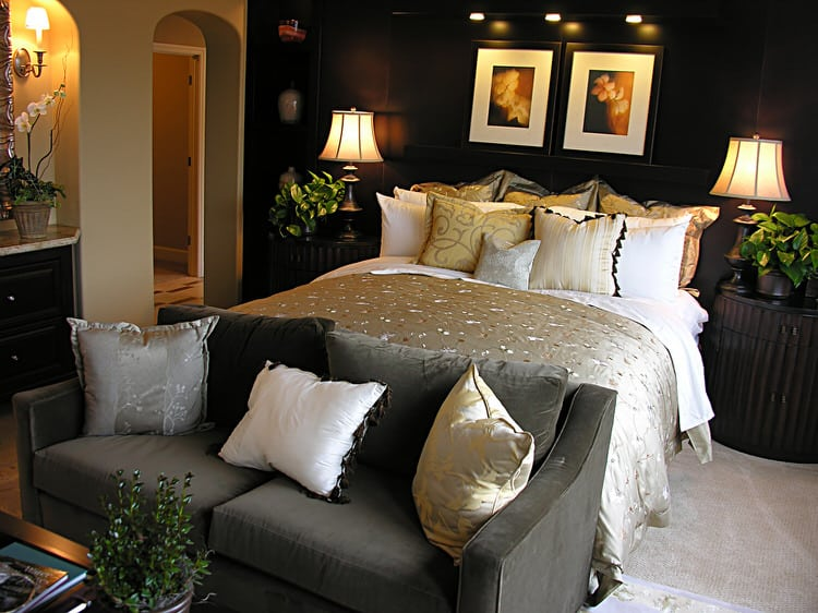 Rich Colors And Plush Carpet Underfoot Make This Master Bedroom The Ideal Place To Get Away And Live In The Lap Of Luxury The Bed And Sofa Are Positioned