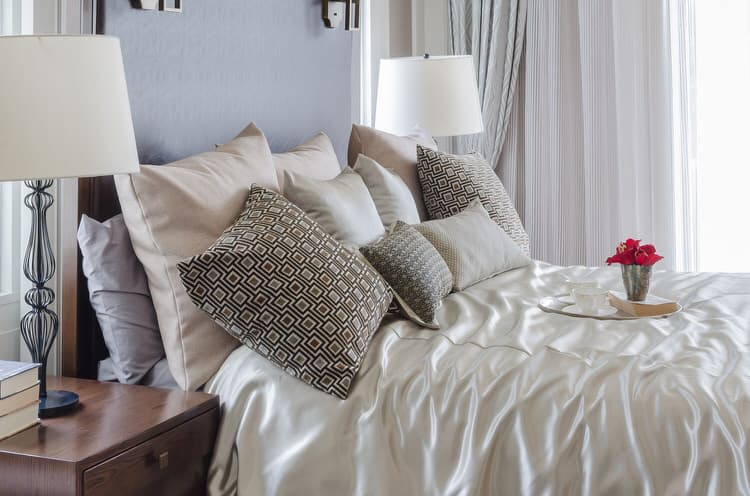 neutrals with colorful undertones are a great way to add subdued color to your bedroom a very light wisteria purple tints the walls the headboard is a