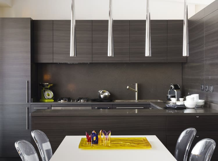 pendant lights have become a natural extension of kitchen islands in this case they provide functional task lighting but also enhance the sleek and ideas