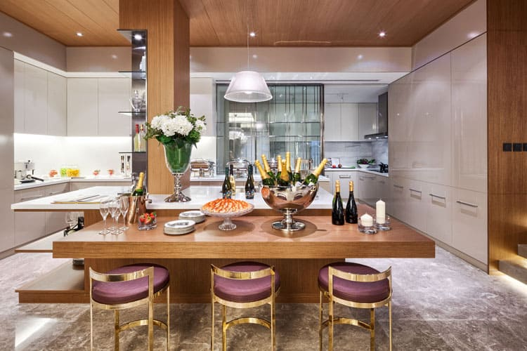 Striking brass counter stools dressed in purple silk look perfect lined up  at this multipurpose integrated dining table  The modern table design is  attached. 25 Modern Dining Room Designs  Many Different Styles