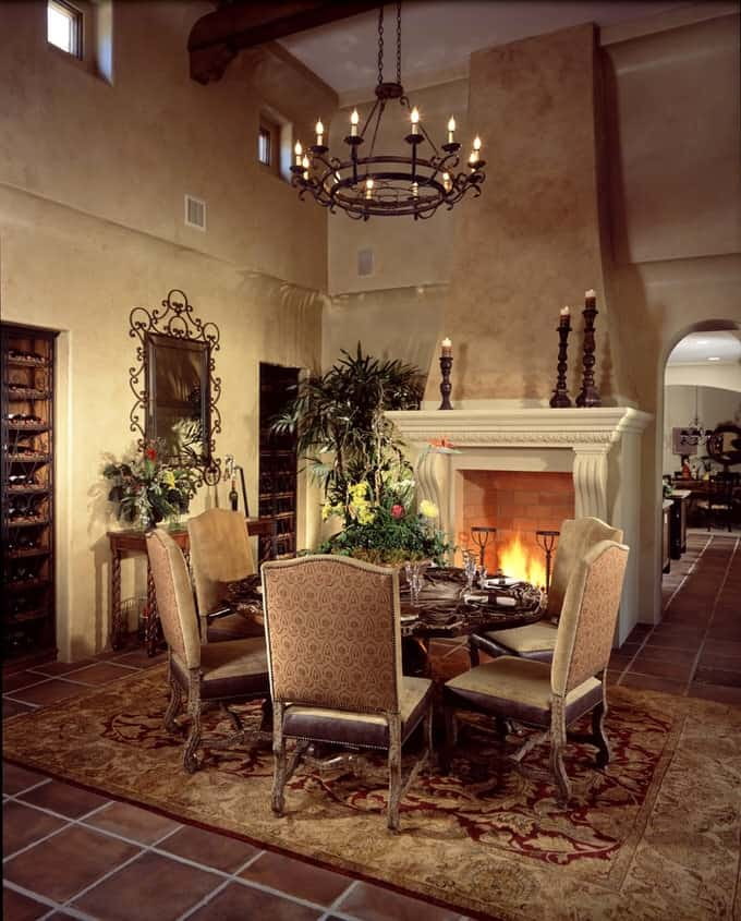 A Massive Cast Stone Fireplace Anchors The Old World Dining Room Giving It Feel Of Spanish Castle Oval Table In Burl Wood Can Seat Six