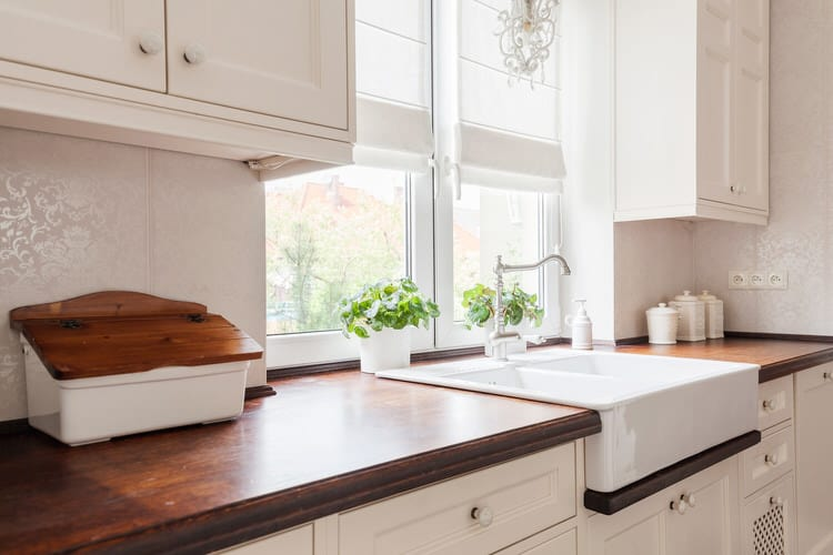 Shaker Cabinets And Farmhouse Details Make This Small Country Kitchen Big  On Style. The Furniture Style Cabinetry And Apron Sink Look Flawless With  The ...