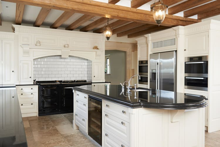This European Farmhouse Kitchen Goes All Out With Restored Wood Ceiling  Beams, Polished Soapstone Counters And A Shiny New Black Range. The Black,  White And ...