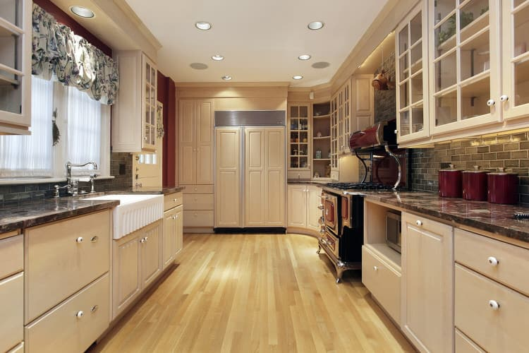 Superior Off White Cabinetry And Blond Maple Flooring Create The Foundation Of This  Alley Like Kitchen. Economical Use Of Space Is Of The Utmost Importance In  This ...