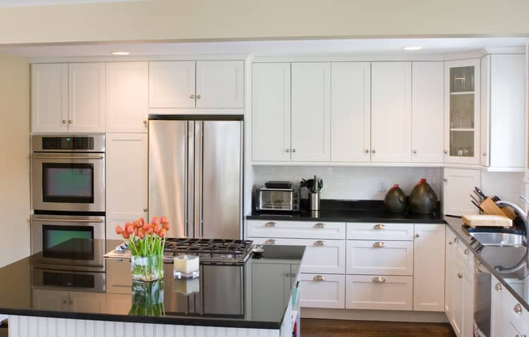 Glamorous Black Granite Counters Are The Perfect Foil For Basic White Cabinets Brushed Nickel Bin Pulls And Knobs Along With Stainless