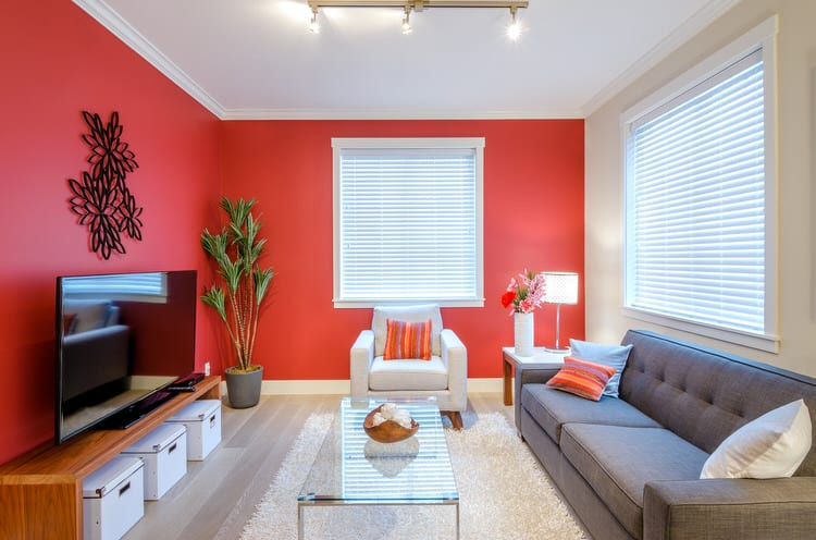 Create A Lively Space By Painting The Walls A Vibrant Shade. This Living  Room Pairs Red And Gray To Create A High Energy, Masculine Room.