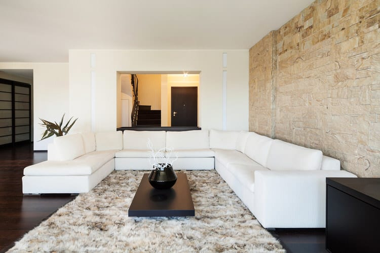 The Luminous Limestone Accent Wall Contrasts With The Espresso Plank  Flooring In This Modern Living Room. The Floor To Ceiling Stunner Dominates. Part 36