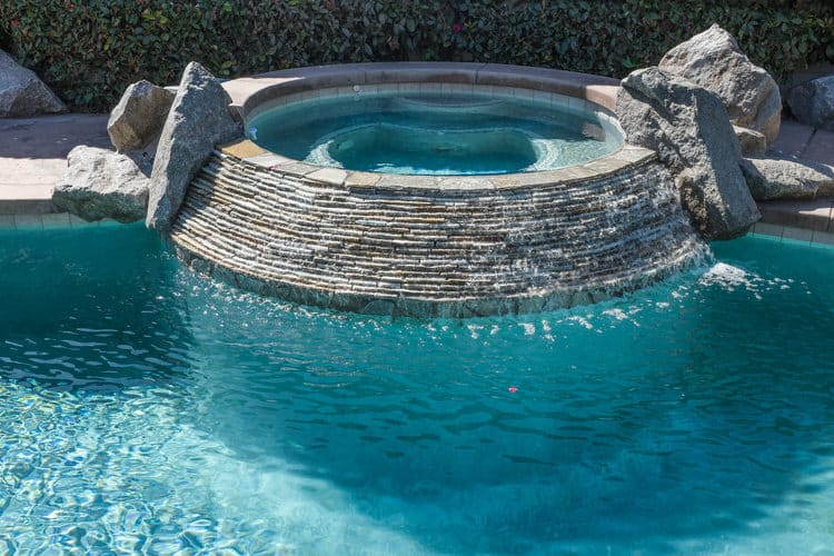 a heated spa is a great idea to transform your pool into a year round entertaining space youll probably enjoy your backyard spa the most on cool evenings - Outdoor Backyard Pools