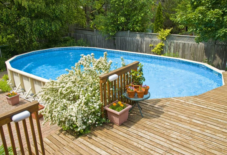above ground pools dont have to be an eyesore this homeowner created a deck around one end connecting the pool to the house they wanted to pool to flow