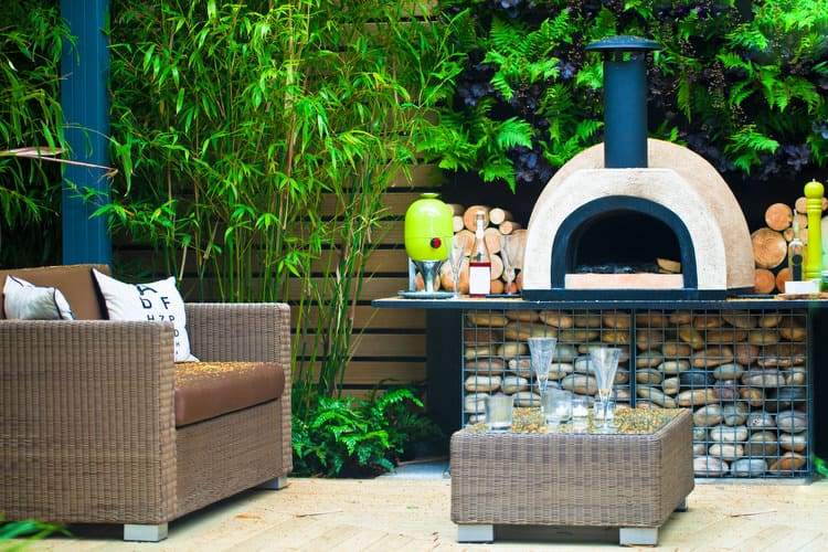 The Clean Lines Of The Faux Wicker Furniture Seem To Work With The Fun And  Funky Handcrafted Pizza Oven And Metal Countertop.