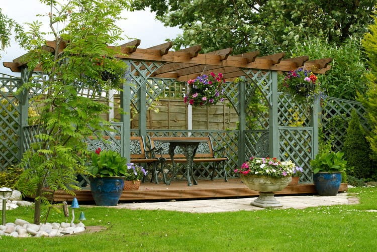 this garden patio complete with a pergola and lattice detail features