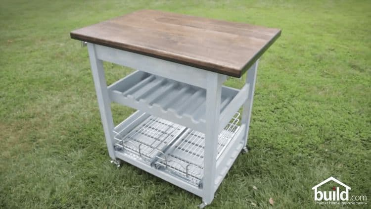 If you need some extra space in the kitchen, this rolling kitchen cart is a great solution. It provides extra space to store your kitchen items as well as additional table space. The best part of this kitchen cart is that it sits on casters so that you can roll it to wherever you need it!