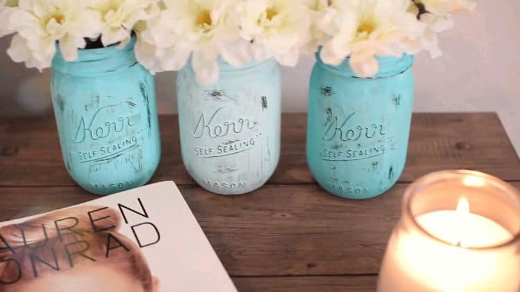 This DIY project provides you with a way to reuse old mason jars and make them into chic and interesting colorful planters for your flowers.