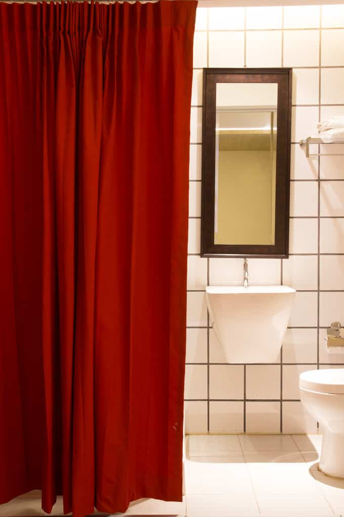 Even A Splash Of Color Like This Crimson Shower Curtain Will Add A Huge  Dose Of Excitement To A Small Bathroom. The White Tile And Fixtures  Maximize Light ...