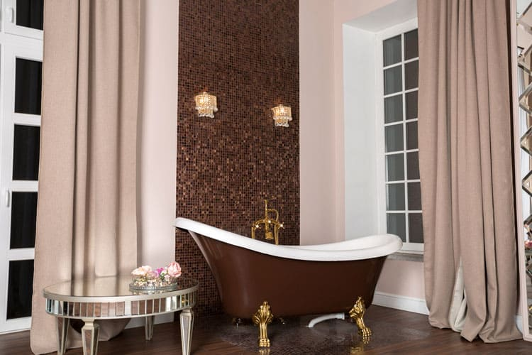 Thick Drapery Drops From The Ceiling And Puddles On Wood Floor Creating A Frame Around This Regal Clawfoot Tub Coordinating Mosaic Accent