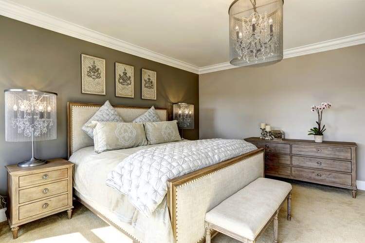Merveilleux This Master Bedroom Design Incorporates Unfinished Floor Planks, Exposed  Brick Walls And Support Beams. A Metal French Canopy Bed Takes Center Stage  In The ...