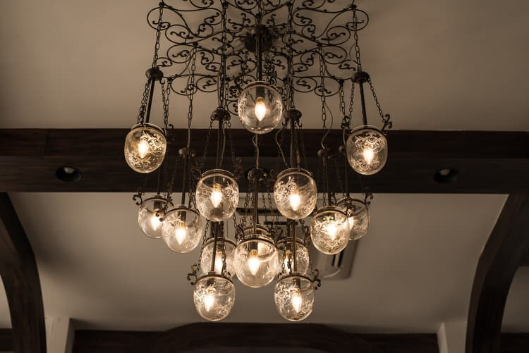 Here The Homeowner Wanted A Simple Bistro Feel So They Chose Round Capiz Shell Chandelier In Gold It Creates Lovely Vignette With Touch Of Luxury