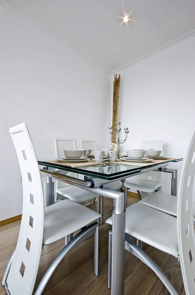 A Stainless Tube Frame And Funky Glass Top Creates An Unusual Dining Room  Addition. Paired With Curved Cutout Chairs, The Overall Look Is Decidedly  Fresh ...