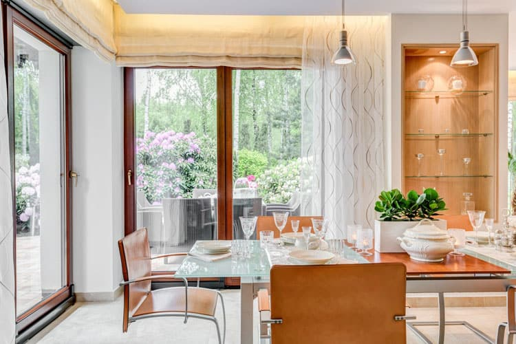 Warm, Wood Tones Of The Breuer Chairs Balance The Lightness Of The Glass  And Metal Dining Table. The Same Look Is Repeated In The Built In Wood And  Glass ...