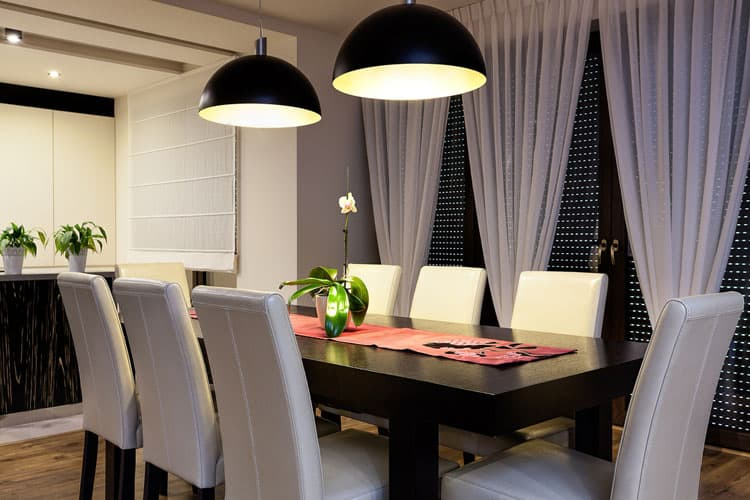 Lighting Is Essential To A Modern Dining Room Create Just The Right Ambience In This City Apartment Oversized Dome Pendants Not Only Reinforce