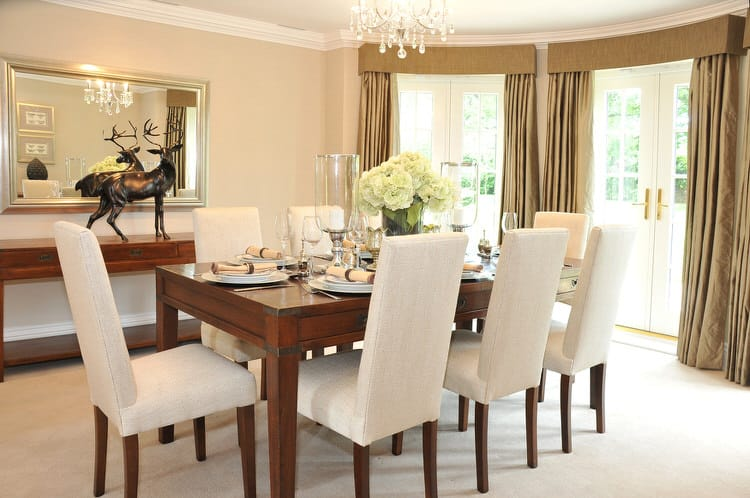 White Molding And Sparkling Accents Keep This Neutral Dining Room From  Appearing Too Washed Out. A Delicate Crystal Chandelier Lights The Table  And The ...