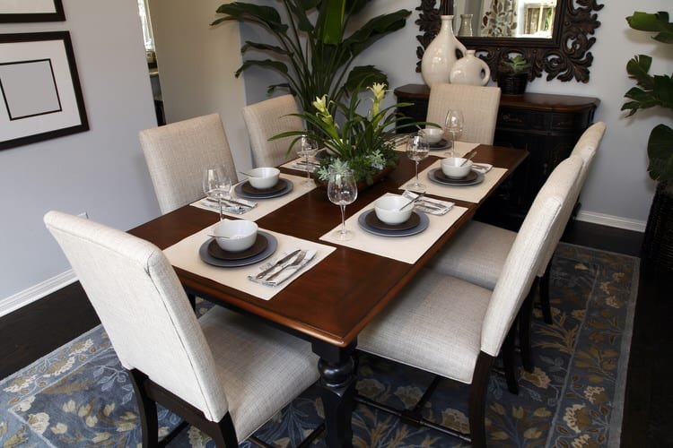 The Dark Furniture Stands In Contrast To Light Floors Woven Gr Placemats And Crisp White Dinnerware Linens Look Blends With Connecting