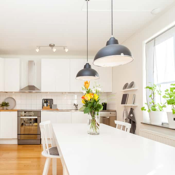 Simplicity is the key in recreating a bucolic kitchen. Take the plain backsplash in this updated country kitchen. White 4×4 tile adds a lovely sheen without ...