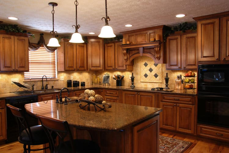 Custom Solid Wood Cabinets And Ornately Carved Range Hood Are Front Center In This Old World Kitchen Quality Quite Y