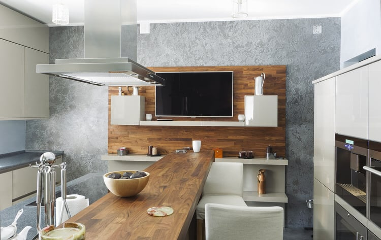 Here Is A Modern Take On A Galley Kitchen. The Wood Island Runs The Length  Of The Space And Intersects With The Focal Wall. Comfortable Counter  Seating On ...