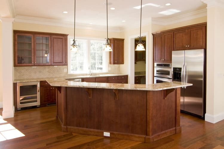 belly up to this bar island that gives you a built in excuse for entertainingthe wine fridge located conveniently nearby behind and below the granite - Kitchen Island With Sink