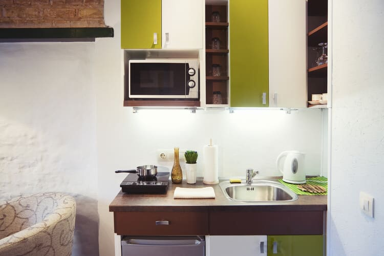 Superbe If You Are A Fan Of The 1970s, You Will Find This Small Kitchen Totally  Groovy. Avocado Green And White Cabinet Doors Give This Efficiency Kitchen  A Retro ...