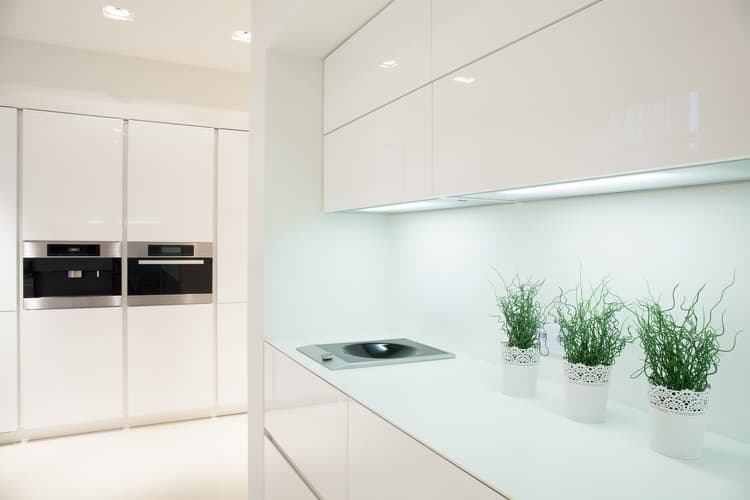 All White Modern Kitchen The deep mahogany floors and ceiling dilute the white and ground the space,  giving this modern kitchen a classic feel. A dark backsplash rounds out a  superb ...
