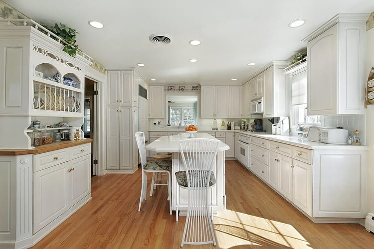 White Kitchens Are Always Por No Matter Their Style Modern Fan Backed Chairs Around The Eat In Island An Intriguing Contrast To