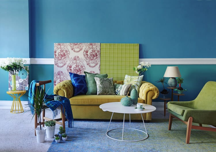 The Walls In This Room Are Painted A Soulful Teal Blue That Is Repeated In  The Flooring By Way Of An Ombre Effect Carpet That Cozies Up This Living  Space.