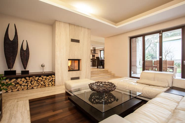 Refined Elegance Black Living Room Set When cold weather hits, the place to be is the leather settee in front of  this modern fireplace. However, the elegant touches of this room can be  enjoyed ...