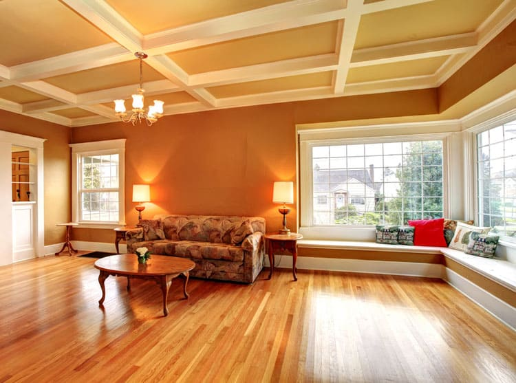 Behold The Formal Features Of This Living Room Coffered Ceiling And Shining Hardwood Floors Make Ideal E For A Tail Party Or Other