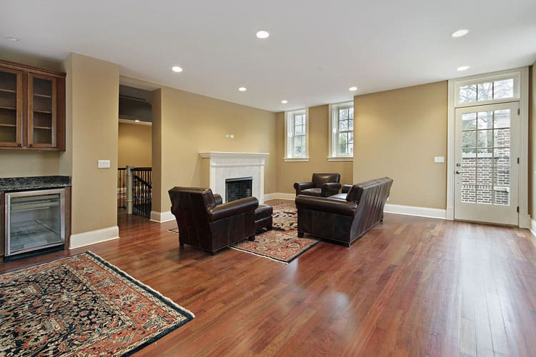 Natural Hardwood Floors Lend A Sophisticated Yet Easy To Maintain Look This Family Room The Matching Leather Furniture Create Cozy Seating Area