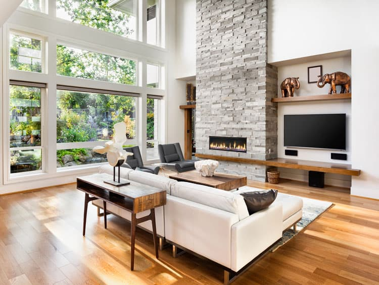 The Blond Hardwood Floors Ground This Modern Airy E White Walls Paired With Furnishings Keep Feeling Light And Clean While Mive