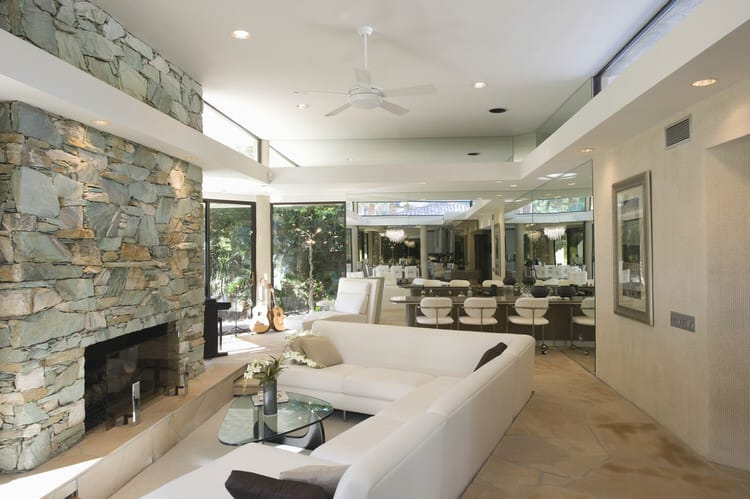 The Designer Decided To Give This Floor To Ceiling Fireplace More  Prominence By Using A Chunky Stacked Stone Effect.